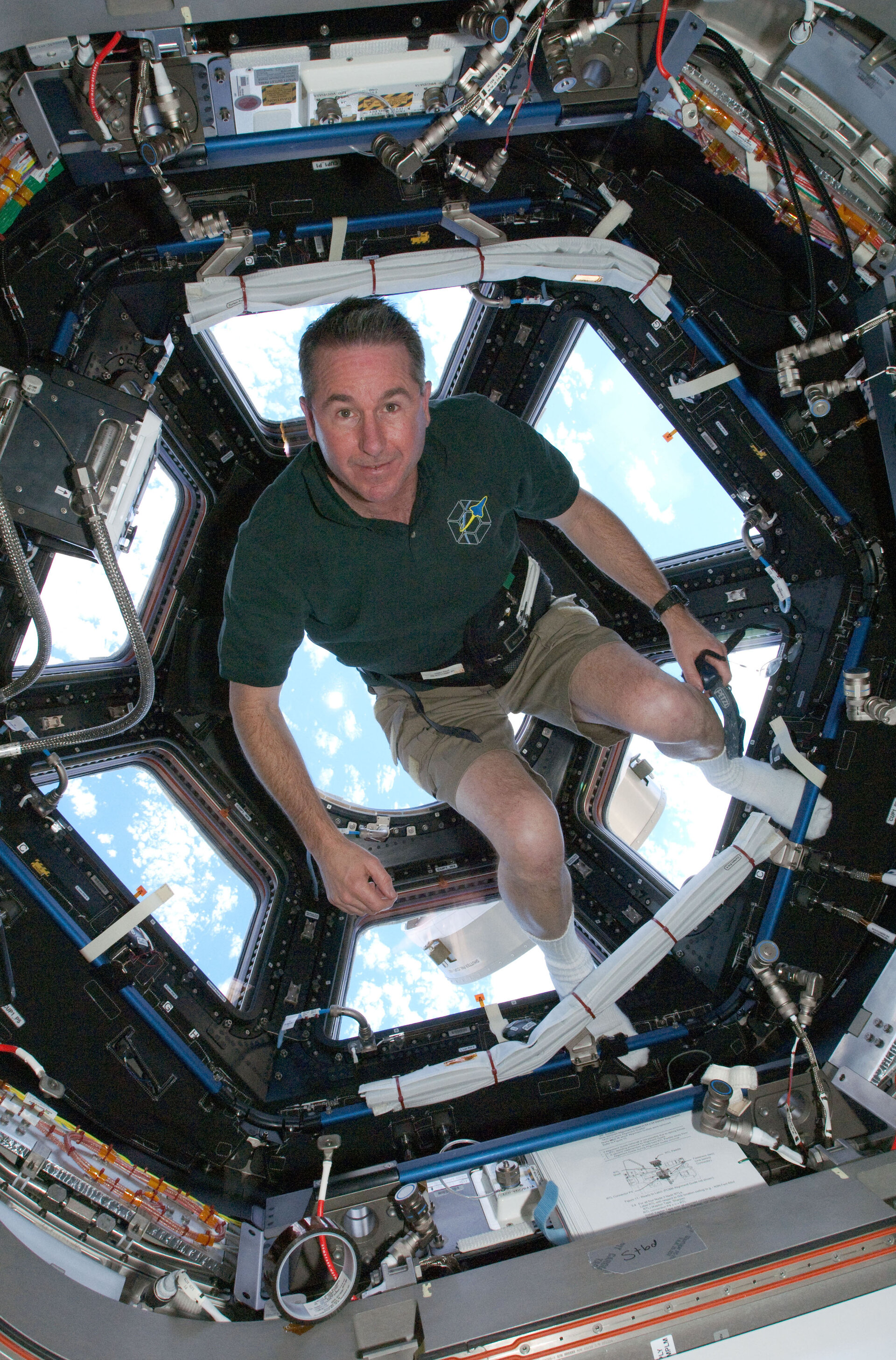 Astronaut Stephen Robinson in the Cupola