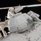 Astronauts Behnken and Patrick remove insulation and bolts from