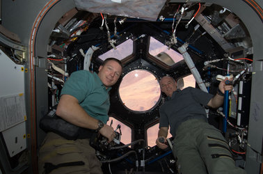 Astronauts Terry Virts and Jeffrey Williams in the Cupola