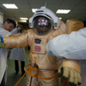 Romain Charles testing a spacesuit