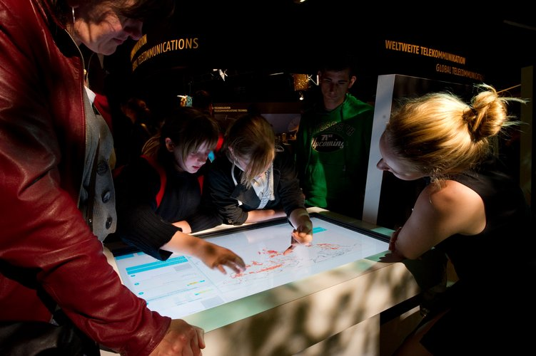 Visitors using Earth Observation interactive screens