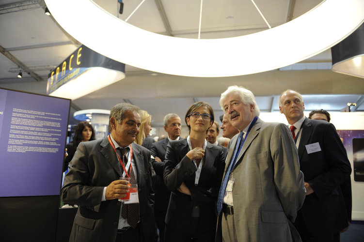E. Saggese, M. Gelmini and D. Southwood visiting the ESA stand