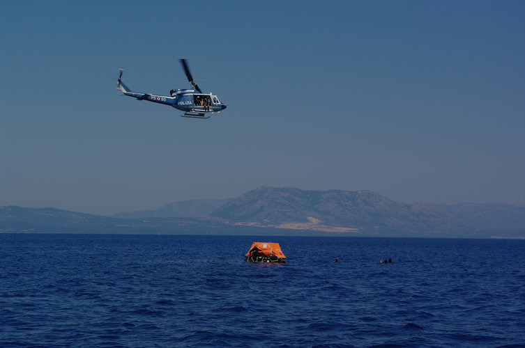 Helicopter flying over the liferaft