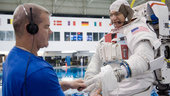 Paolo Nespoli gets help donning a training version of his EMU sp