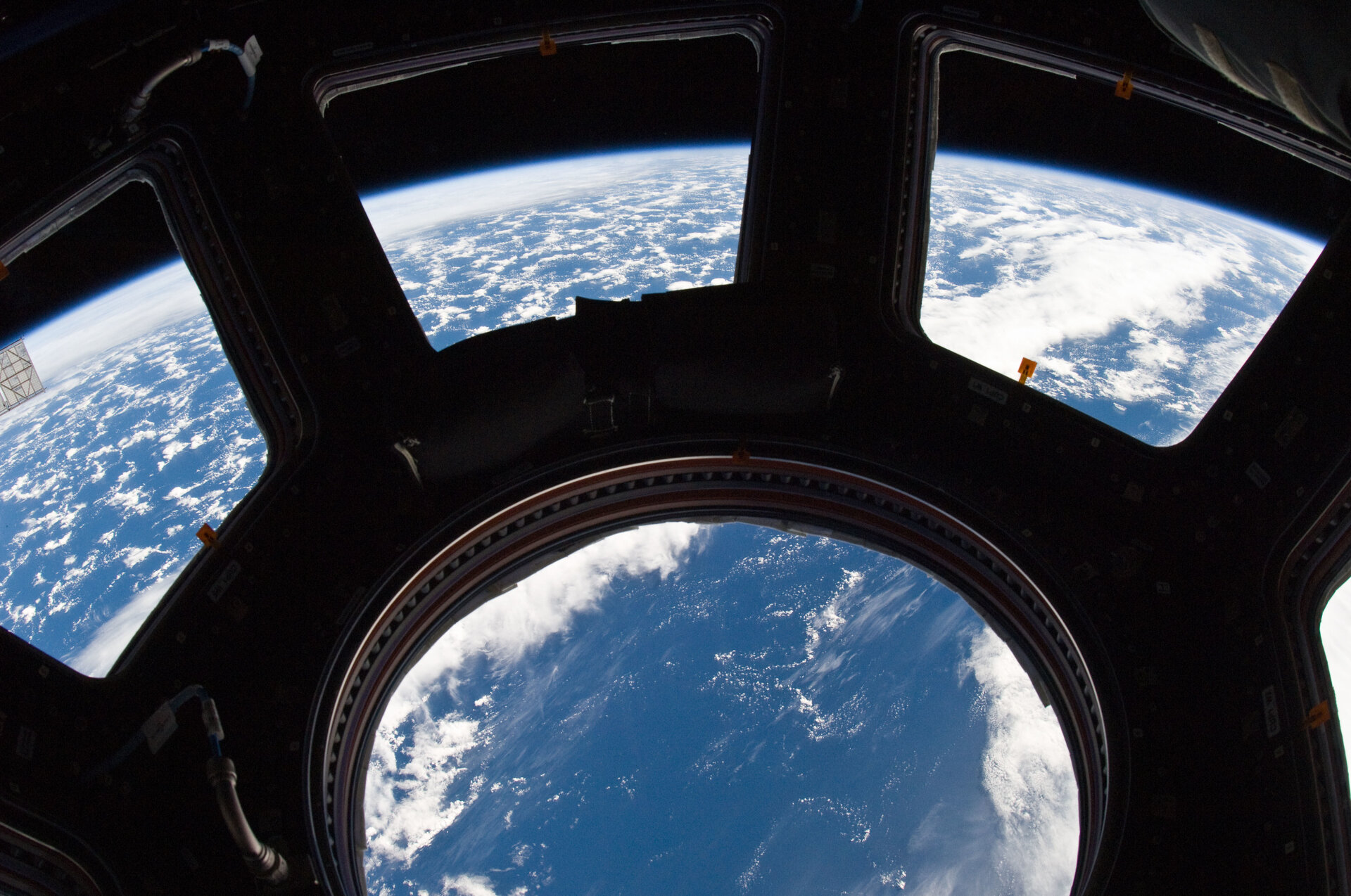 Earth and its horizon seen through the windows in Cupola