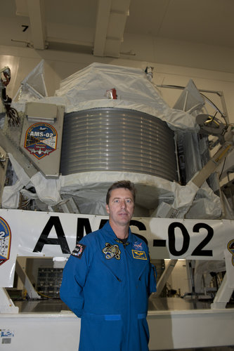 Roberto Vittori in front of AMS-02