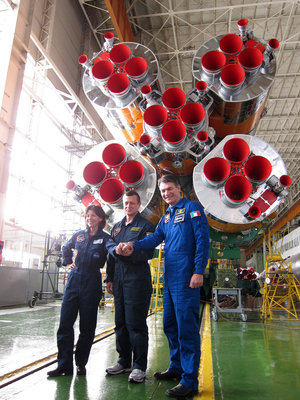 Coleman, Kondratyev and Nespoli with their Soyuz launcher