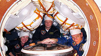 Astronauts inside the Soyuz at L-5