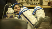 Paolo Nespoli dons his Sokol pressure suit in the MIK preparatio