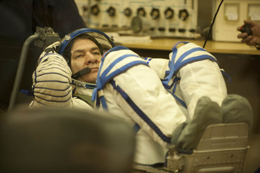 Paolo Nespoli dons his Sokol pressure suit in the MIK preparation building