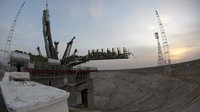 The Soyuz launcher is erected on the launch pad