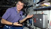 Paolo Nespoli shows a food warmer on ISS