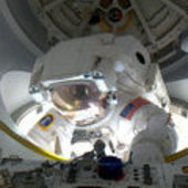 Al Drew half way through the ISS airlock