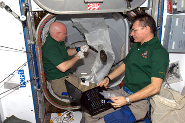 Closing the ISS hatches before Discovery's departure