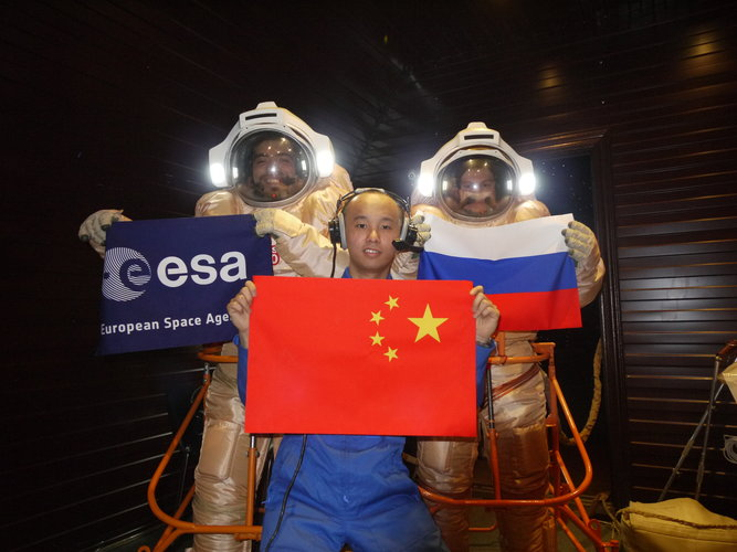 Diego, Alexandr and Wang with flags