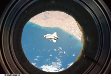Discovery as seen from ISS