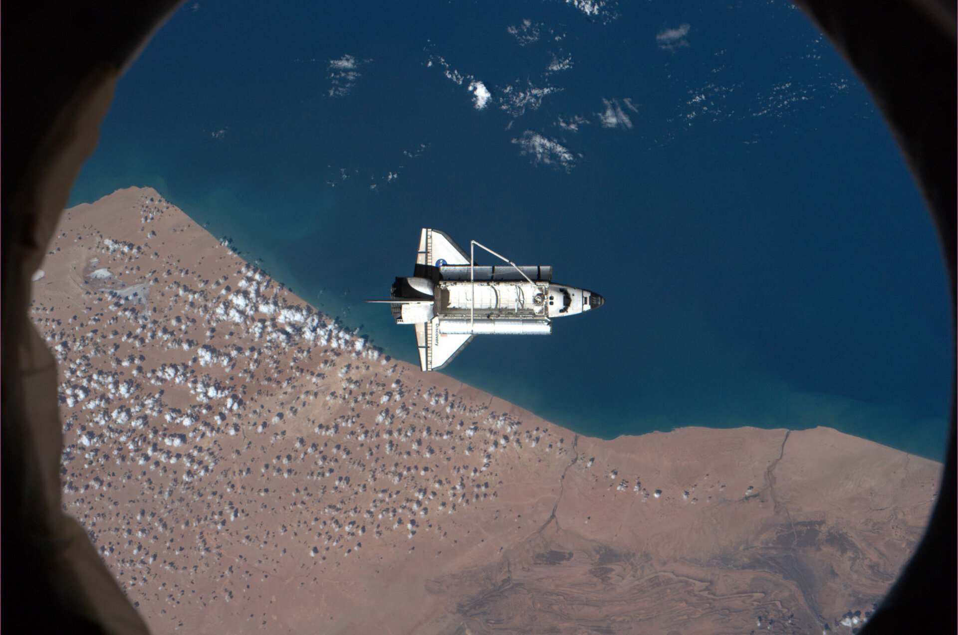 Discovery, over southern Morocco during the ISS fly around before departure