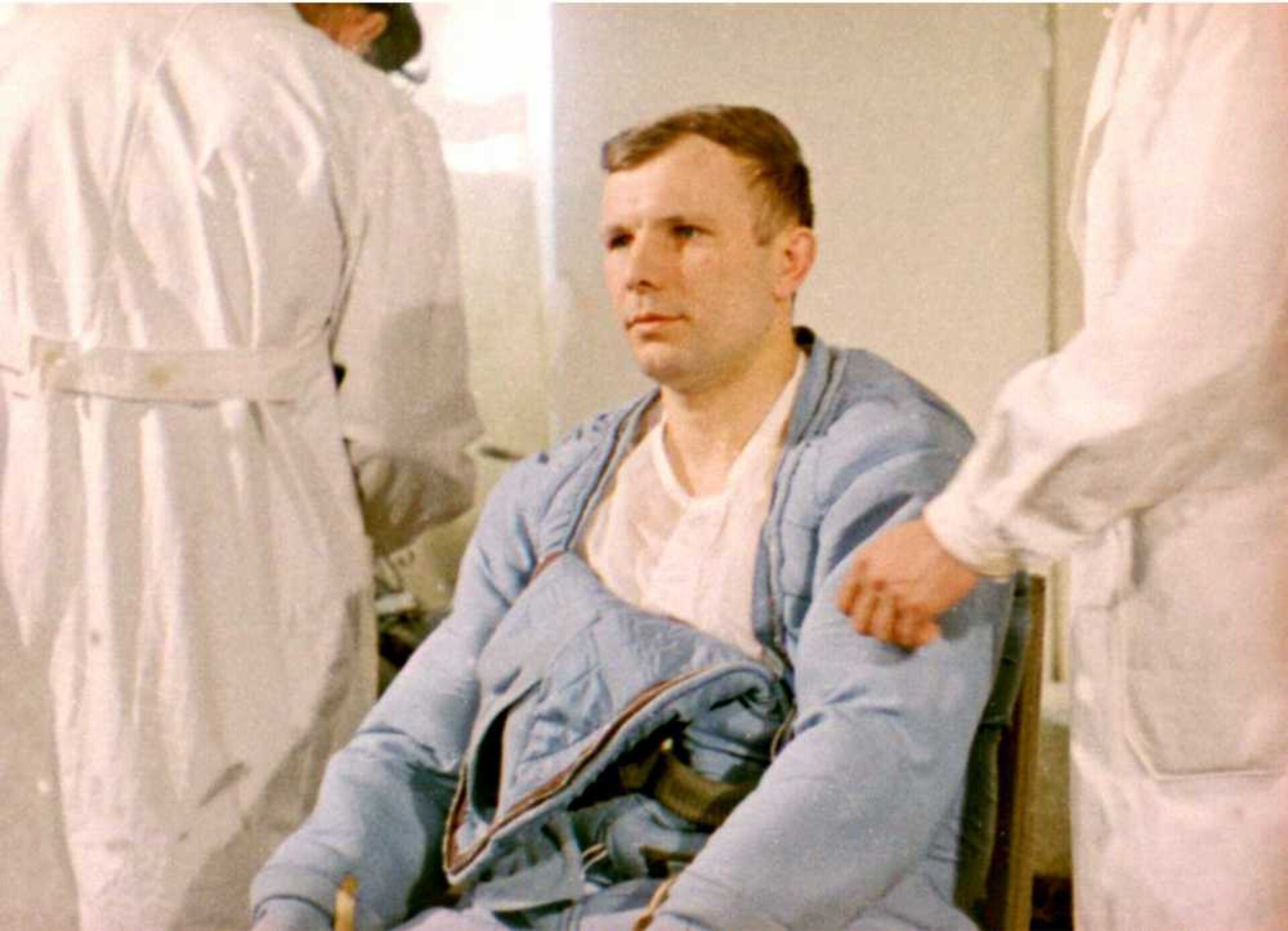 Gagarin is helped in suiting up