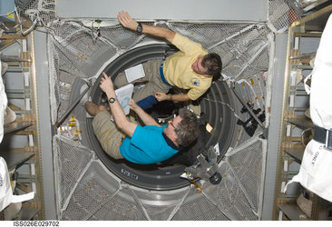 Paolo Nespoli and Alexander Kaleri working in ATV-2