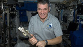 Paolo Nespoli with a can crusher