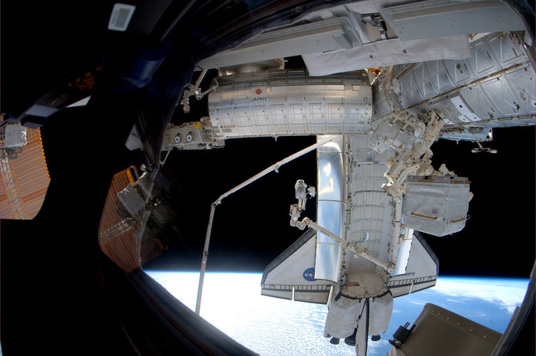 Steve Bowen takes a picture while spacewalking