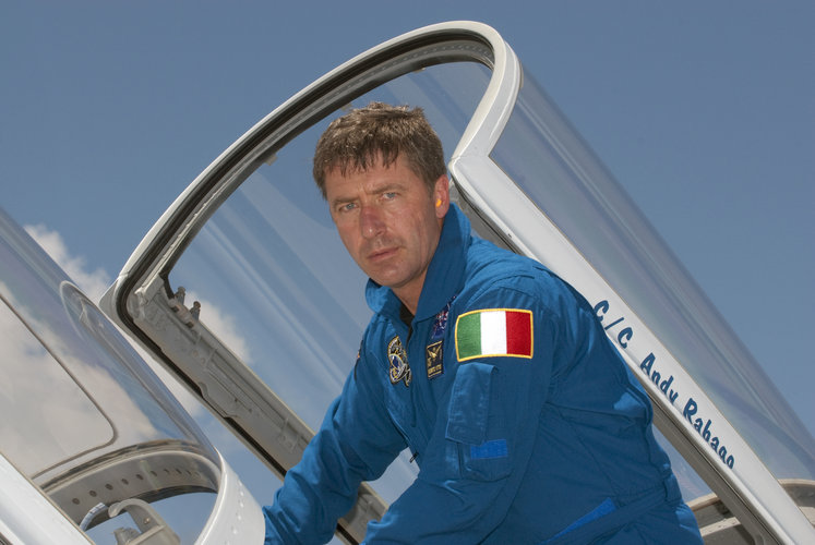 Roberto Vittori climbs out of a T-38 jet