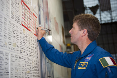 Vittori signing the space shuttle wall tribute