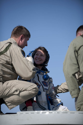 Catherine having a pause on the hatch of the Soyuz