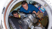 Dmitri and Paolo closing the Soyuz hatch