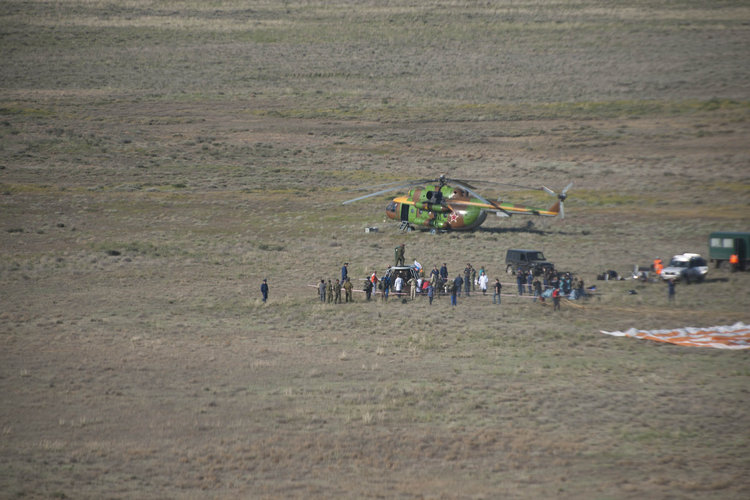 Soyuz TMA-20 surrounded by the ground crews