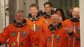 STS-134 crew walk out