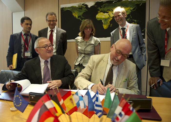 Dordain (left) and Zourek signing the agreement