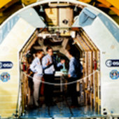 Owen Garriott and Ulf Merbold brief George Bush inside Spacelab
