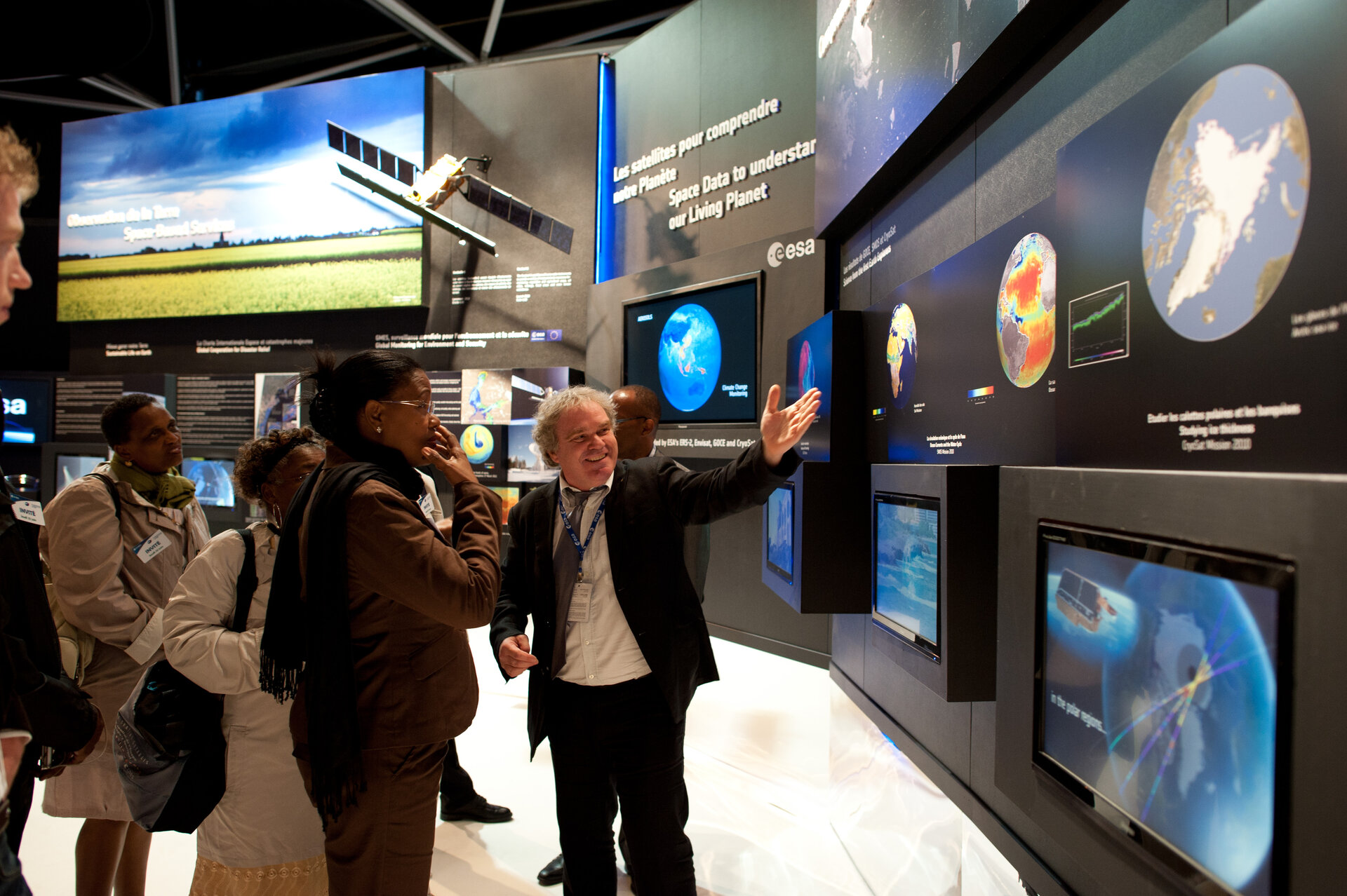 Staffs of the Europe's Spaceport and Dominique Detain visit the ESA pavilion