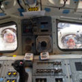 Spacewalkers look through Shuttle's aft flight deck windows