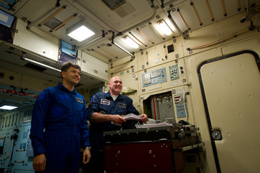 André Kuipers and Oleg Kononeko inside a Zarya module simulator