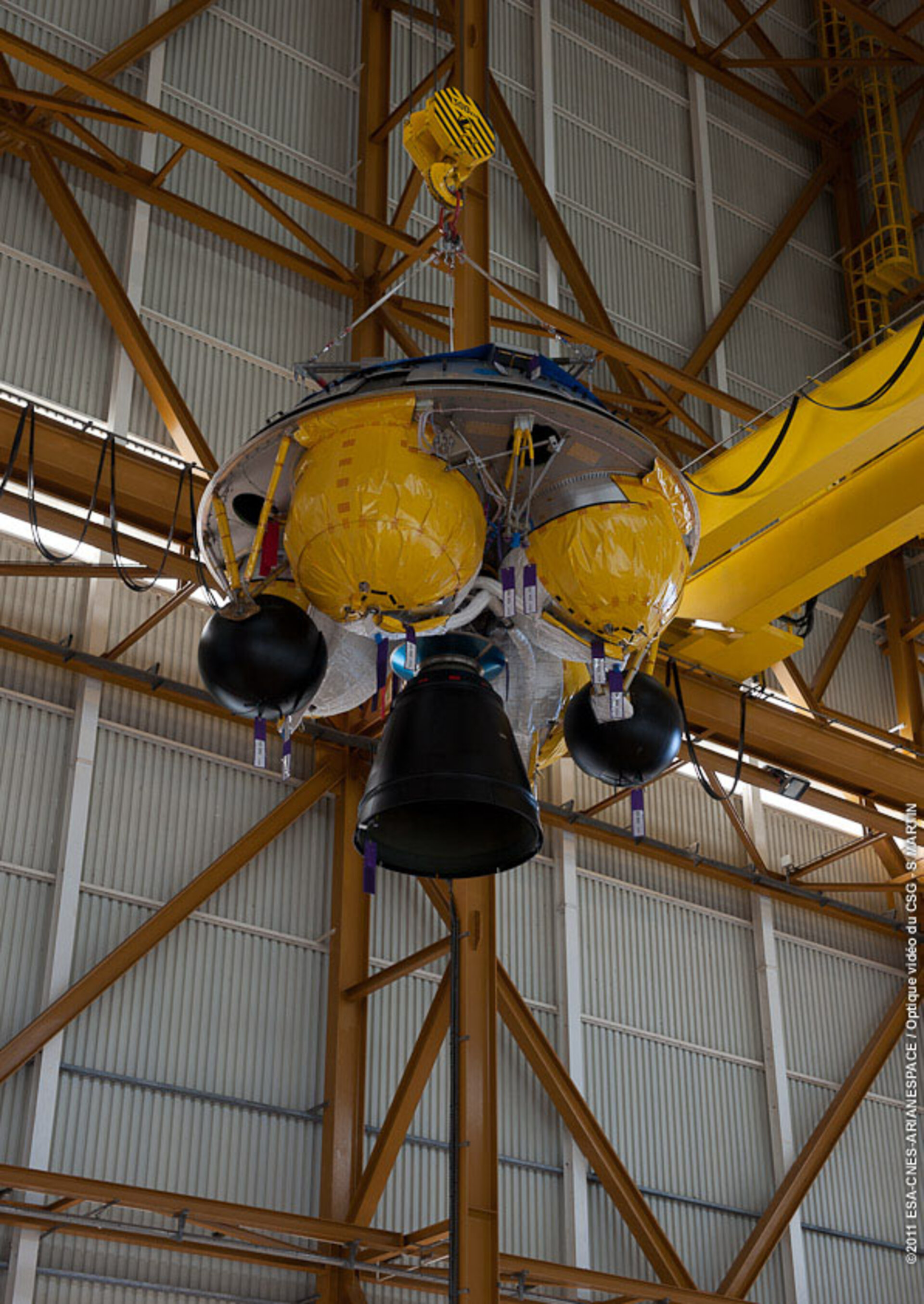 ATV-3 Booster section hoisted into position