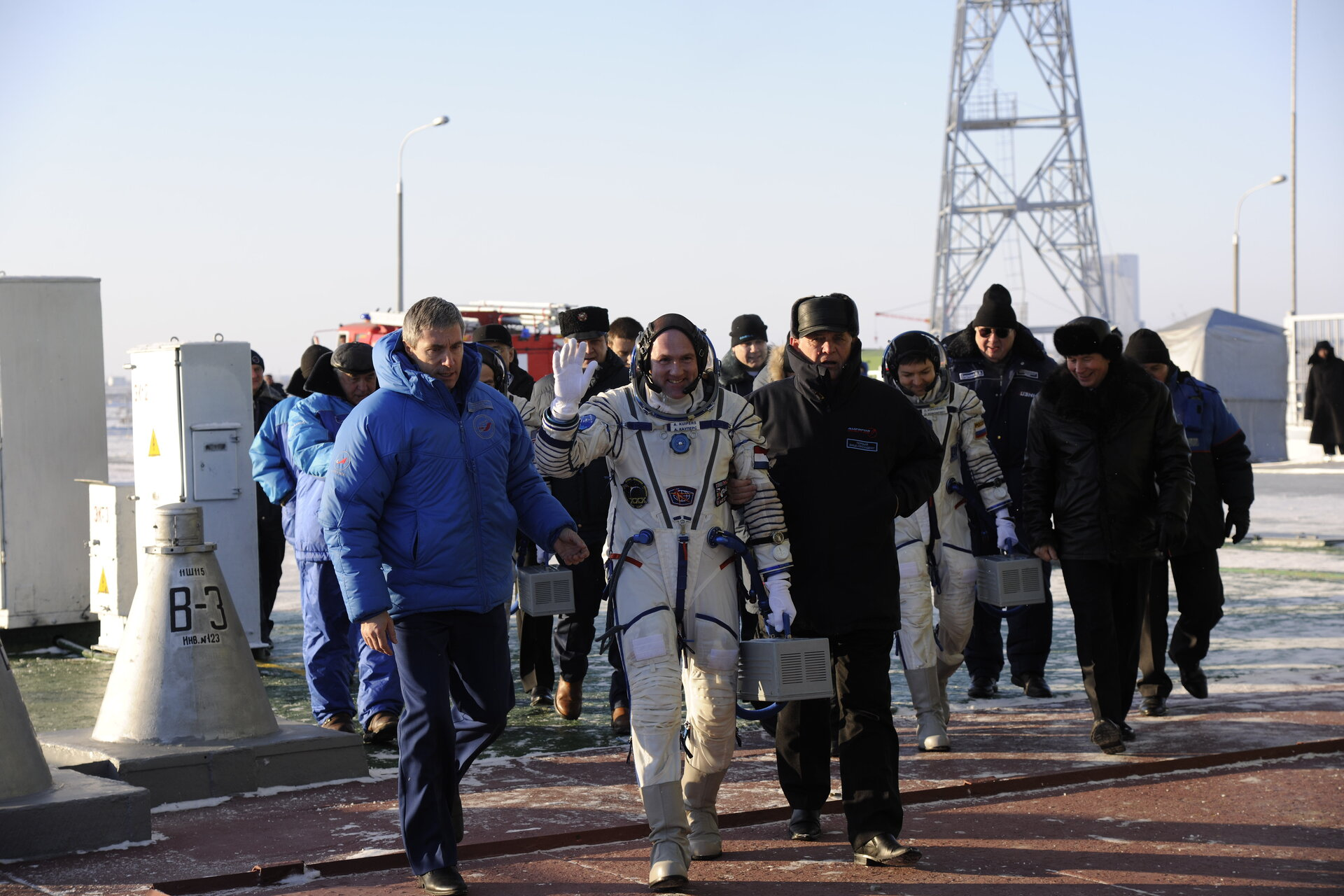 Expeditions 30 and 31 crew members prepare to take the elevator to the top of the Soyuz rocket