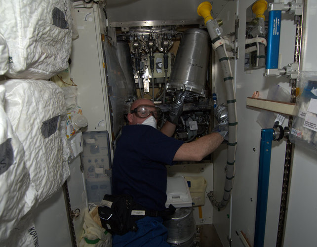 Andre Kuipers performing maintenance onboard the ISS