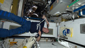 Andre Kuipers shaving his head aboard the ISS.