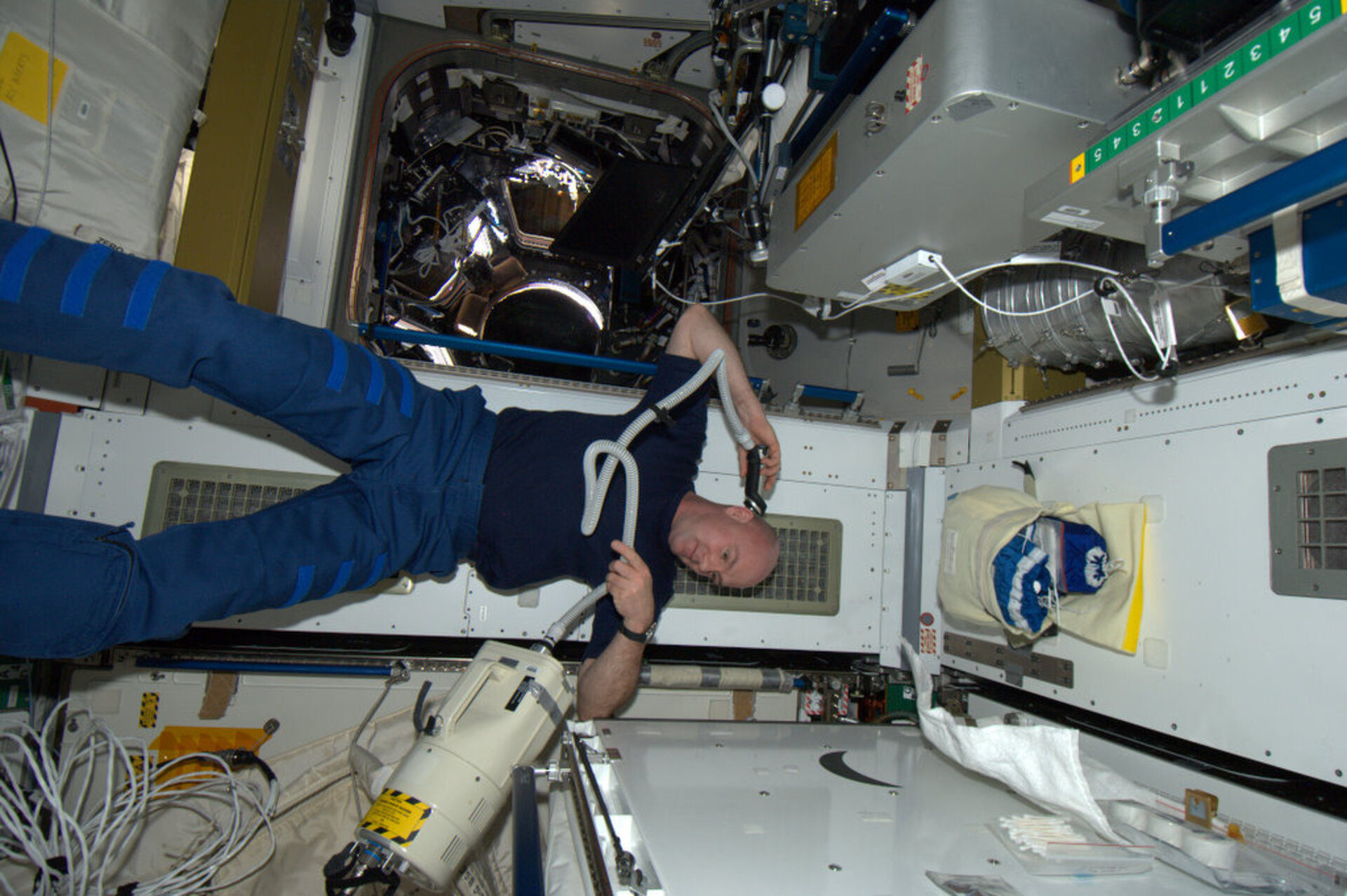 Andre Kuipers shaving his head onbard the ISS