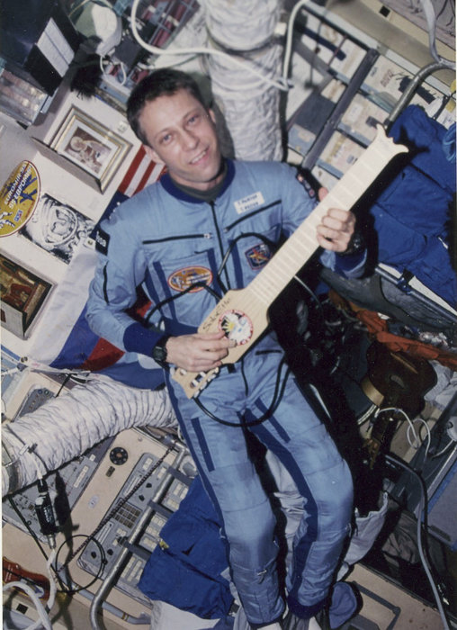 astronaut playing guitar in space - photo #18