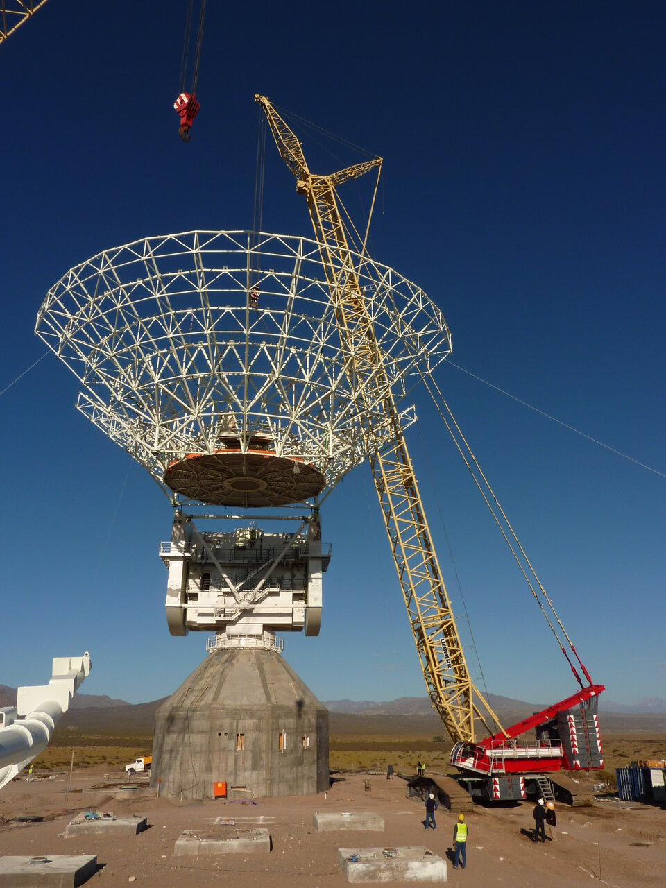 Lifting the huge DSA-3 antenna dish into place