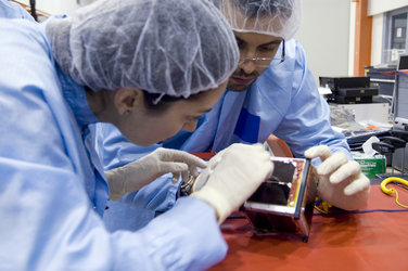 e-st@r team clean their CubeSat before integration