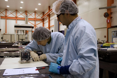 The Xatcobeo team unpack their CubeSat for inspection