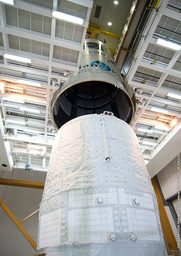 Ariane 5 fairing slowly being lowered over ATV-3