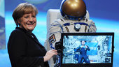 Chancellor Angela Merkel talking to André Kuipers at CeBIT 2012.
