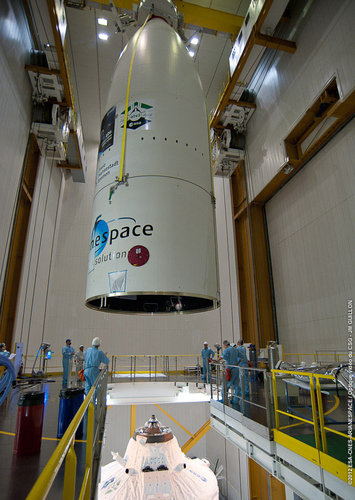 Giant Ariane 5 fairing suspended over top of ATV-3