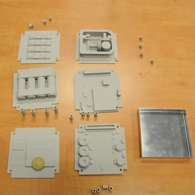 Model components laid out with fifty Euro cent coin to show relative size