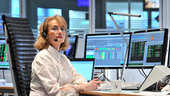 Operations engineer Colette Pullig readies for launch in the Main Control Room at ESOC